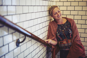 Mid adult woman standing in a stairwell in Stockholm, Swedenの写真素材 [FYI02705673]