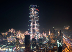 Cityscape of Dubai, United Arab Emirates at night, with fireworks and illuminated skyscrapers.の写真素材 [FYI02705797]