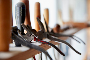 A violin maker's workshop. A rack of hand tools along the window.の写真素材 [FYI02705929]