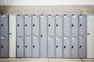 A row of grey metal lockers in a bicycle factory.の写真素材 [FYI02705980]