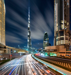 Cityscape of Dubai, United Arab Emirates at dusk, with skyscrapers, illuminated Burj Kalifa in the cの写真素材 [FYI02705991]