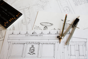 Close up of design drawings for furniture and a compass.の写真素材 [FYI02706169]