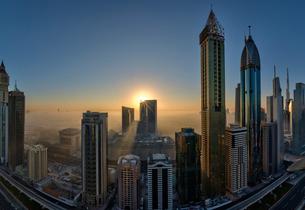 Cityscape with illuminated skyscrapers in Dubai, United Arab Emirates at dusk.の写真素材 [FYI02706244]