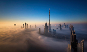 View of the Burj Khalifa and other skyscrapers above the clouds in Dubai, United Arab Emirates.の写真素材 [FYI02706319]
