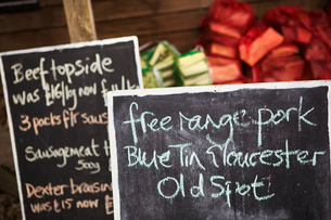 Close up of handwritten blackboard at farm shop advertising free range pork and beef.の写真素材 [FYI02706388]