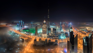 Cityscape of Dubai, United Arab Emirates with illuminated Burj Khalifa and other skyscrapers.の写真素材 [FYI02706431]