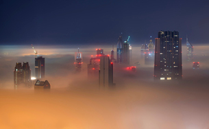 Cityscape with view of skyscrapers above the clouds in Dubai, United Arab Emirates.の写真素材 [FYI02706456]