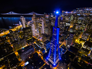 Transamerica Pyramid lit up and outlined in blue lights, and viewed from above, and the cityscape ofの写真素材 [FYI02706522]