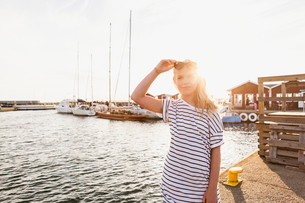 Teenage girl standing at the harbor in Hano, Swedenの写真素材 [FYI02706678]