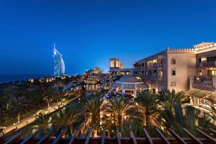Cityscape of the Dubai, United Arab Emirates at dusk, with illuminated buildings and the Burj Al Araの写真素材 [FYI02706762]