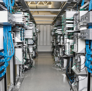 Server room aisle showing computer servers and CAT 5 cables.の写真素材 [FYI02706802]