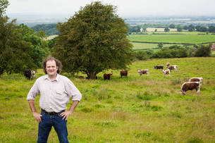 Man and a herd of English Longhorn cattle in a pasture.の写真素材 [FYI02706850]
