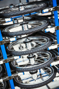 Bicycle wheels suspended from the ceiling in a bicycle factory.の写真素材 [FYI02706858]