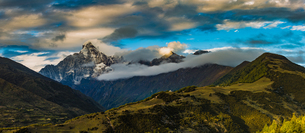 Mount Siguniang under sunlight through the gray cloud; Sichuan; Chinaの写真素材 [FYI02707487]