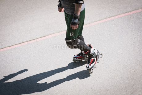 High angle view of man roller skating on footpathの写真素材 [FYI02708760]