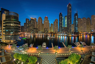 Cityscape of Dubai, United Arab Emirates at dusk, with skyscrapers and the marina in the foreground.の写真素材 [FYI02708922]