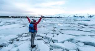 Woman standing on ice floe, Jokulsarlon glacier lagoonの写真素材 [FYI02709220]