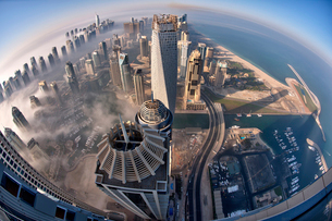 Aerial view of cityscape with skyscrapers above the clouds in Dubai, United Arab Emirates.の写真素材 [FYI02709423]
