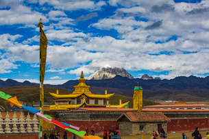 Muya Golden Tower against the sky with white cloud in front of Yala Snow Mountainの写真素材 [FYI02709692]
