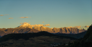 Sunlight Shadow covering the Haba Snow Mountain; Yunnan; Chinaの写真素材 [FYI02709720]