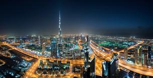 Cityscape of Dubai, United Arab Emirates at night, with the Burj Khalifa skyscraper in the distance.の写真素材 [FYI02709775]