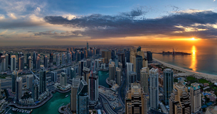 Cityscape of Dubai, United Arab Emirates at dusk, with skyscrapers lining coastline of the Persian Gの写真素材 [FYI02709801]