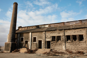 Exterior view of an abandoned building and industrial chimney.の写真素材 [FYI02709849]