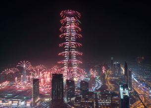 Cityscape of Dubai, United Arab Emirates at night, with fireworks and illuminated skyscrapers.の写真素材 [FYI02709924]