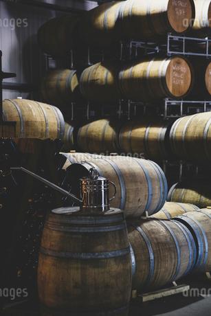 Oak wood wine barrels in a cellar, stacked up.の写真素材 [FYI02709986]