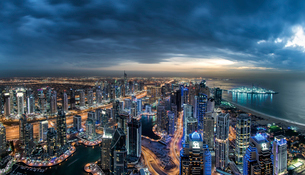 Cityscape of Dubai, United Arab Emirates at dusk, with skyscrapers lining coastline of the Persian Gの写真素材 [FYI02710232]