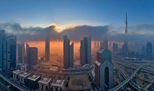 Cityscape with illuminated skyscrapers in Dubai, United Arab Emirates at dusk.の写真素材 [FYI02710533]