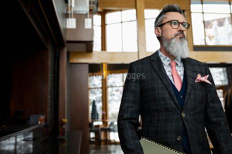 Fashionable hipster businessman in restaurantの写真素材 [FYI02712594]