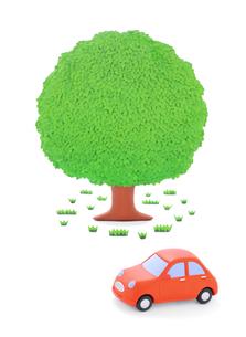 赤い粘土の車と大樹の写真素材 [FYI02721981]