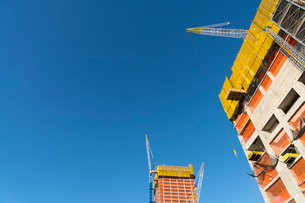 ハドソンヤード再開発プロジェクト建設現場のクレーンと建設中の高層ビルの写真素材 [FYI02739293]