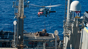 An MH-60S Sea Hawk delivers supplies to the flight deck of Uの写真素材 [FYI02741530]