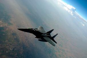 An F-15E Strike Eagle breaks away from a KC-135 Stratotankerの写真素材 [FYI02741796]
