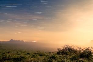 Meteor shower over tranquil landscape, Naestved, Denmarkの写真素材 [FYI02741957]