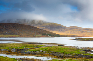 Tranquil scene clouds over rolling hills and lake, Loch Aineort, South Uist, Outer Hebridesの写真素材 [FYI02742009]