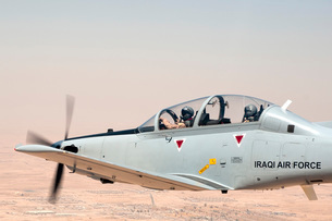 A T-6 Texan flying over Camp Speicher, Tikrit, Iraq.の写真素材 [FYI02742610]