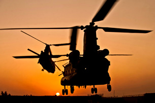 Two Royal Air Force CH-47 Chinooks take off from headquarters in Afghanistan.の写真素材 [FYI02742725]