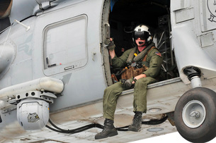 Naval Aircrewman acts in an SH-60B Sea Hawk helicopter.の写真素材 [FYI02742790]
