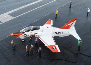 Sailors refuel a T-45 Goshawk on the flight deck of USS George H.W. Bush.の写真素材 [FYI02742902]