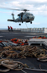 An HH-60H Seahawk helicopter prepares to lift a crate of ordの写真素材 [FYI02743025]