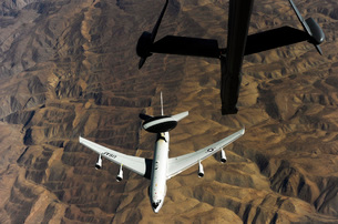 A U.S. Air Force E-3 Sentry aircraft over Afghanistan.の写真素材 [FYI02743105]