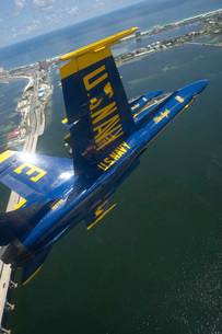 An F/A-18 Hornet of the Blue Angels over Pensacola Beach, Florida.の写真素材 [FYI02743148]