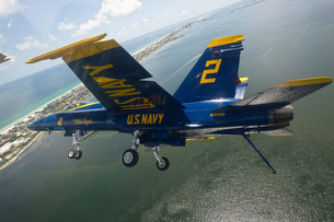 An F/A-18 Hornet of the Blue Angels in flight over Pensacola Beach, Florida.の写真素材 [FYI02743242]