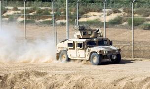 A M1114 Humvee patrols the perimeter of Joint Bae Balad, Iraの写真素材 [FYI02743264]