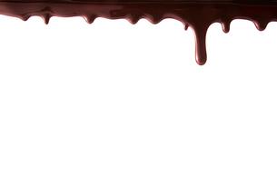 上から垂れ落ちる溶けたチョコレートの写真素材 [FYI02824528]