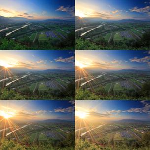 千曲公園から望む千曲川と上田市街と上田原古戦場と朝日の写真素材 [FYI02826044]