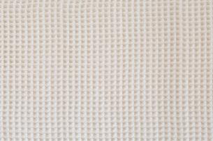 ベージュのワッフル織りのコットンの布の写真素材 [FYI02833400]